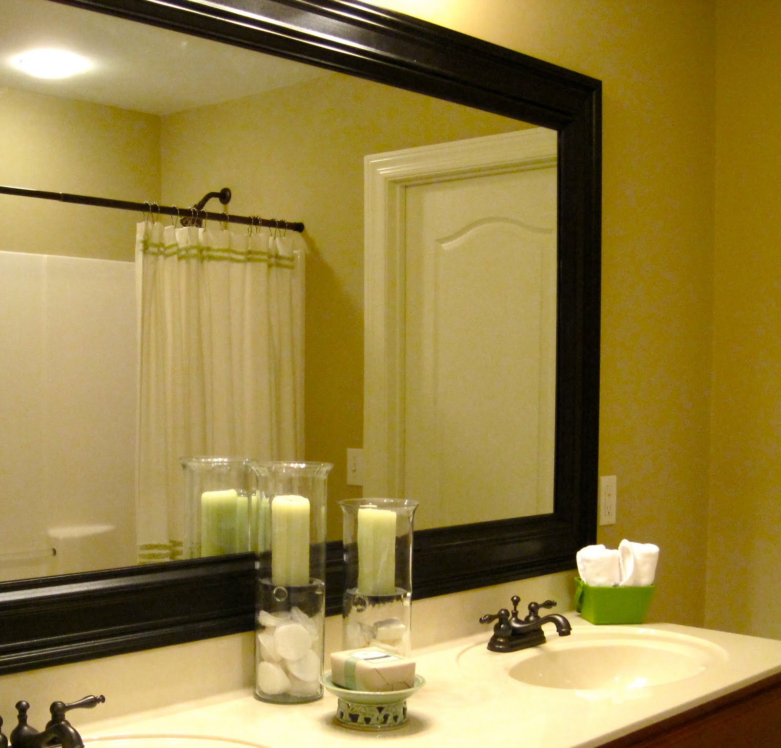 how to add a frame to your bathroom mirror