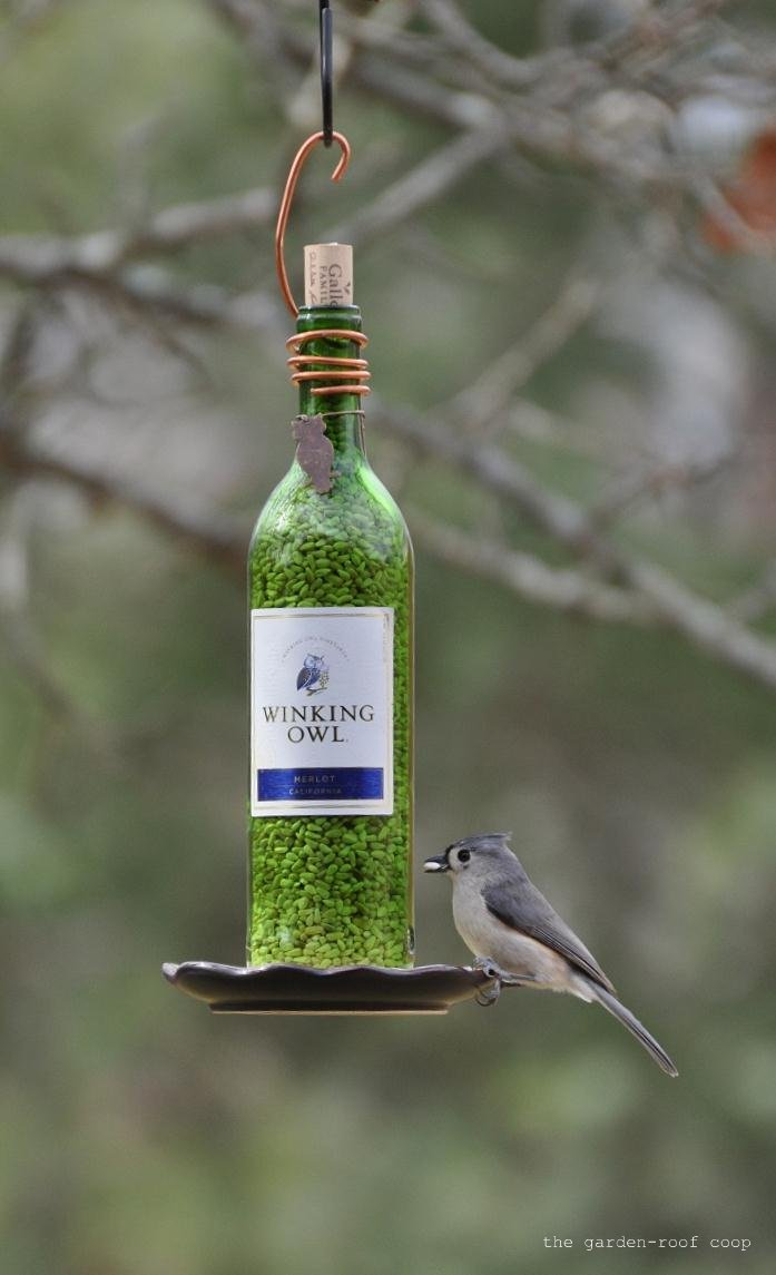 How to make a pretty wine bottle bird feeder for How to build a bird feeder easy